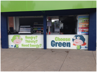 Front counter of Lara Pool Kiosk with 'Choose Green' signage.