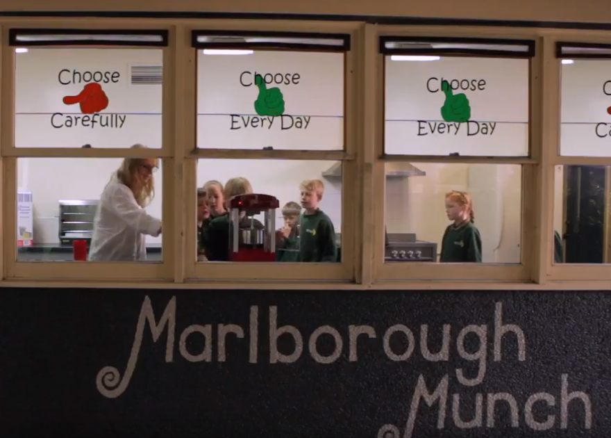 Photo of the Marlborough Munch canteen front, with people behind the windows.