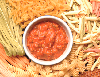 Bowl of vegetarian bolognese surorunded by pasta