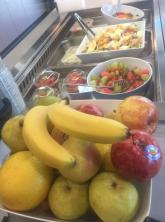 Fridge display that includes a fruit bowl, fruit salads and yoghurt options.