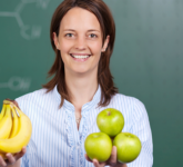 Teacher holding fruit