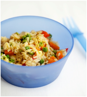 Bowl of vegetarian fried rice with fork