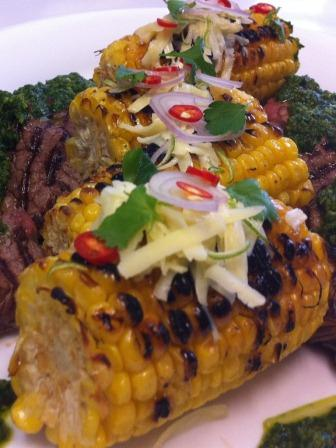 Berbecued corn and steak on a platter