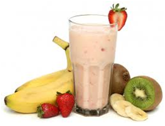 berry smoothie in a glass, and pieces of fruit
