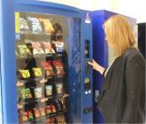 Woman using vending machine
